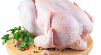 Raw,Chicken,Carcass,On,The,Cutting,Board,Isolated,On,White