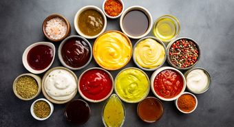 Set,Of,Different,Bowls,Of,Various,Dip,Sauces,,On,Dark