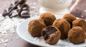 Homemade,Healthy,Vegan,Chocolate,Truffles,With,Dates,,Coconut,Flakes,And