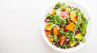 Fresh,Salad,With,Fruits,And,Greens,On,White,Wooden,Background